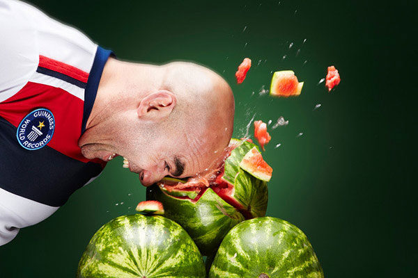 Crushing a watermelon with the head