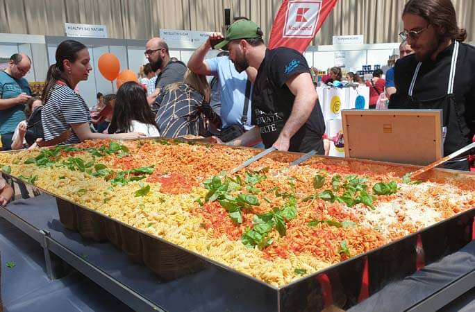 Largest serving of gluten-free pasta at 166.30 kg