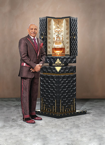 Asghar Adam Ali Ibrahim , owner of Nabeel Perfumes who designed the record-breaking bottle